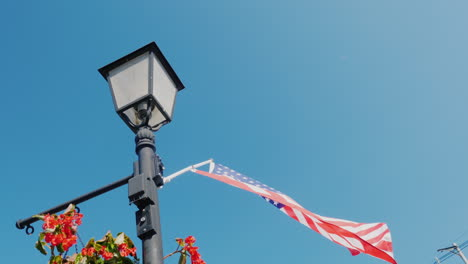 Lamppost-With-Flowers-And-Usa-Flag