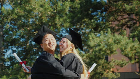 Graduates-Congratulate-Each-Other-On-Graduating-From-College-Hugging