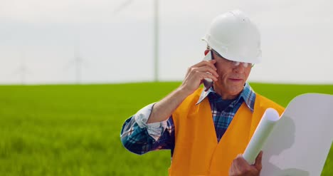 Engineer-Talking-On-Mobile-Phone-While-Walking-In-Farm-7
