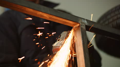 Industry-Worker-Grinding-Metal-With-Angle-Grinder