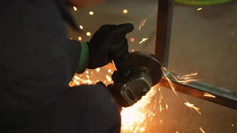 Angle-Grinder-Cutting-Metal-At-Workshop-7
