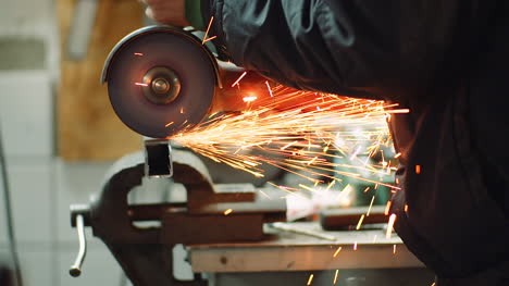 Angle-Grinder-Cutting-Metal-At-Workshop-10