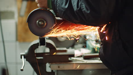 Angle-Grinder-Cutting-Metal-At-Workshop-11