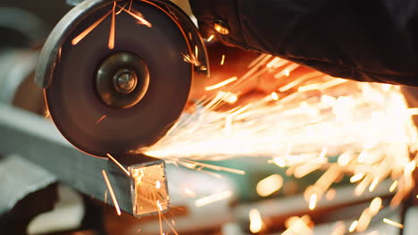 Angle-Grinder-Cutting-Metal-At-Workshop-14