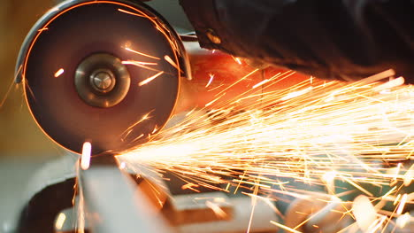 Industry-Worker-Grinding-Metal-With-Angle-Grinder-1