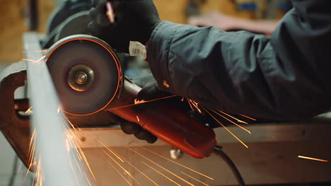 Industry-Worker-Grinding-Metal-With-Angle-Grinder-4