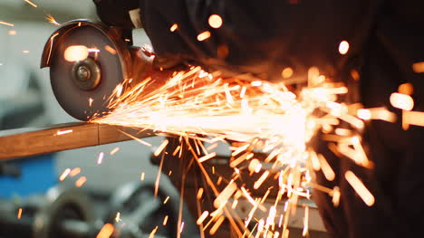 Industry-Worker-Grinding-Metal-With-Angle-Grinder-5