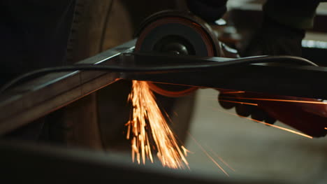 Industry-Worker-Grinding-Metal-With-Angle-Grinder-6