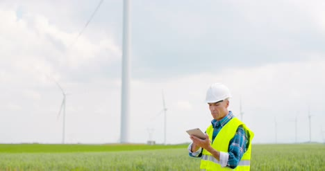 Engineer-Using-Digital-Tablet-When-Doing-Wind-Turbine-Inspection