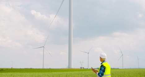 Engineer-Using-Digital-Tablet-When-Doing-Wind-Turbine-Inspection-5