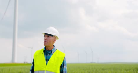 Engineer-Using-Digital-Tablet-When-Doing-Wind-Turbine-Inspection-7