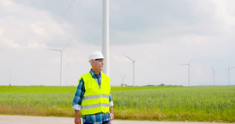 Engineer-Using-Digital-Tablet-When-Doing-Wind-Turbine-Inspection-8