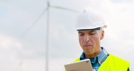Engineer-Using-Digital-Tablet-When-Doing-Wind-Turbine-Inspection-9