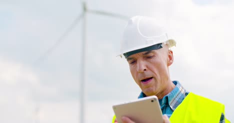 Engineer-Using-Digital-Tablet-When-Doing-Wind-Turbine-Inspection-10