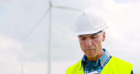 Engineer-Using-Digital-Tablet-When-Doing-Wind-Turbine-Inspection-11