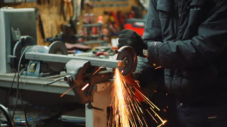 Angle-Grinder-Cutting-Metal-At-Workshop-29