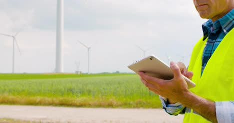 Engineer-Using-Digital-Tablet-When-Doing-Wind-Turbine-Inspection-12