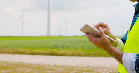 Engineer-Using-Digital-Tablet-When-Doing-Wind-Turbine-Inspection-2