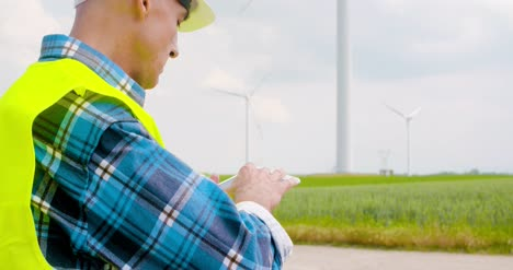 Engineer-Using-Digital-Tablet-When-Doing-Wind-Turbine-Inspection-3