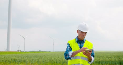 Engineer-Using-Digital-Tablet-When-Doing-Wind-Turbine-Inspection-4