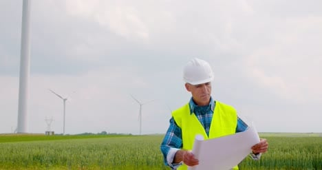 Engineer-Working-On-Windmills-Farm-Reading-Plan