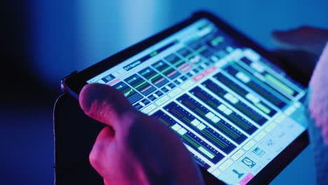 A-Professional-Sound-Engineer-Uses-A-Tablet-Near-The-Stage-Controls-The-Sound-Of-The-Music-Group-Hd-