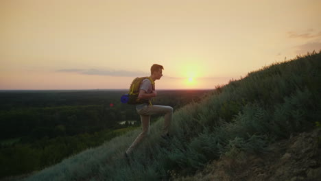 The-Guy-The-Teenager-With-A-Backpack-Climbs-Up-The-Mountain-At-Sunset-Active-Way-Of-Life-Since-Youth