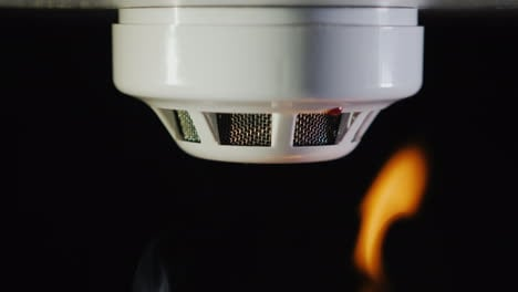 The-Smoke-Detector-Is-Triggered-By-A-Fire-Smoke-And-Flames-Are-Visible-4k-Video