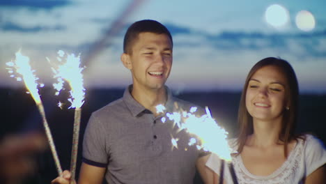 Young-People-Having-Fun-At-A-Party-Playing-With-Fireworks-And-Bengal-Lights-Slow-Motion-10-Bit-Video