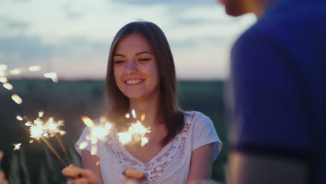 Young-Couple-Having-Fun-With-Fireworks-Slow-Motion-10-Bit-Video