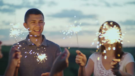 Friends-With-Fireworks-In-Their-Hands-Having-Fun-At-A-Party-In-The-Evening