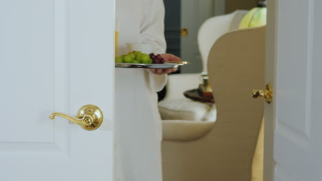 A-Woman-In-A-Bathrobe-Brings-Breakfast-To-The-Room-Romantic-Morning