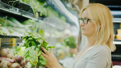 Young-Woman-Carefully-Chooses-Lettuce-In-The-Store-Healthy-Lifestyle-And-Proper-Nutrition