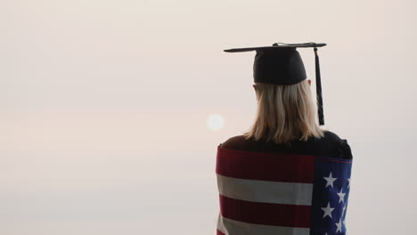 Rear-View-Of-A-Graduate-With-The-Flag-Of-Usa-Study-In-Us