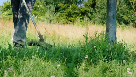 Trimmer-Head-Mows-Grass-With-A-Rotating-Line-Close-Up-Shot