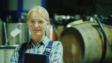 Portrait-Of-A-Laboratory-Assistant-Woman-In-Protective-Glasses-On-The-Background-Of-Wine-Barrels