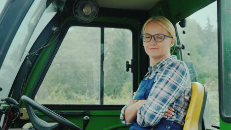 Tractor-Driver-Woman-Portrait-Smiling-Looking-At-The-Camera