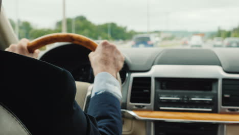 Businessman-In-A-Business-Suit-Driving-A-Car-The-Frame-Shows-The-Hands-Of-A-Man-On-The-Steering-Whee