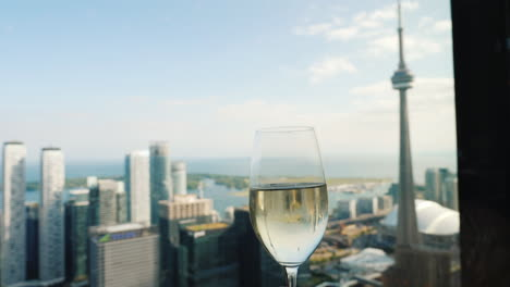 Raise-A-Glass-Of-Champagne-By-The-Window-Where-You-Can-See-The-Famous-Cn-Tower---A-Symbol-Of-Toronto