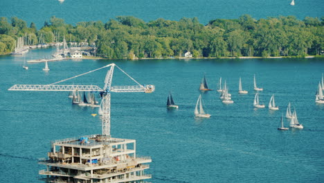 View-Of-The-Construction-Of-A-Skyscraper-In-The-Background-There-Are-Many-Yachts-In-The-Bay-Toronto-