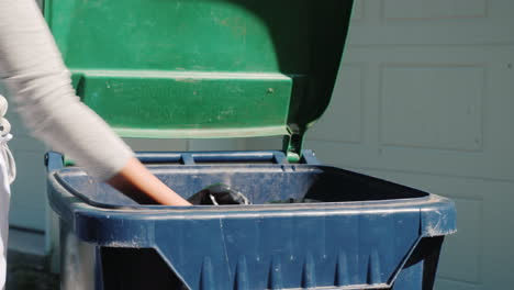 Housewife-Throws-A-Bag-Of-Garbage-Into-The-Tank-Near-The-House