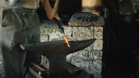 Traditional-Crafts---A-Blacksmith-Forges-An-Ironwork-Only-A-Hammer-And-Anvil-Are-Visible-In-The-Fram