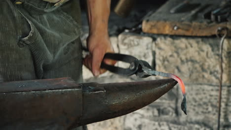 A-Blacksmith-Makes-A-Product-Of-Iron-Hits-The-Anvil-With-A-Hammer-Antique-Crafts