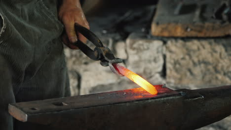 A-Skilled-Blacksmith-Beats-With-A-Hammer-On-A-Red-Hot-Metal-Blank