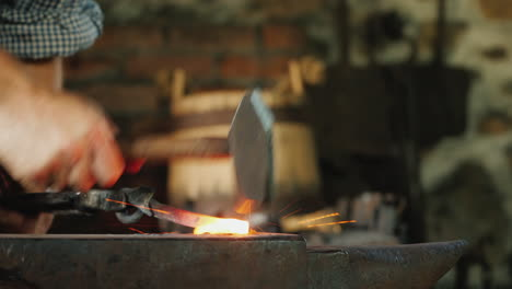 A-Blacksmith-Works-In-A-Forge-A-Close-Up-Of-The-Anvil-And-The-Red-Hot-Billet-On-Which-The-Hammer-Bea