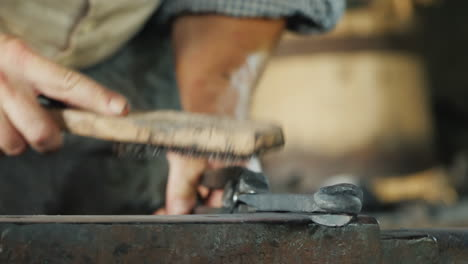 A-Blacksmith-With-A-Metal-Brush-Cleans-The-Workpiece-From-Scale-And-Debris-Artisan-Craftsmanship