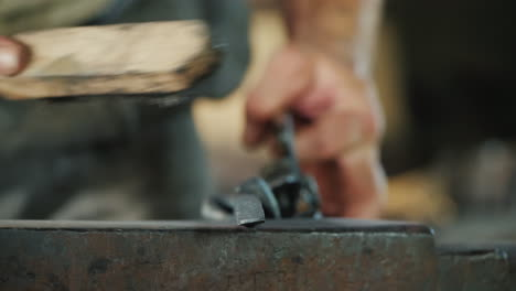 A-Man-Cleans-A-Metal-Product-From-Scale-Blacksmith-At-Work
