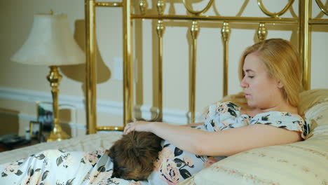 Pregnant-Woman-Playing-With-Her-Dog-Resting-In-Her-Room-On-The-Bed