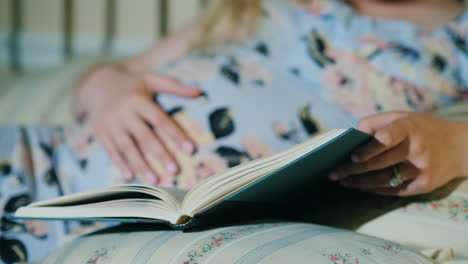 Pregnant-Woman-Reads-A-Book-In-Her-Bed-Close-Up-Shot