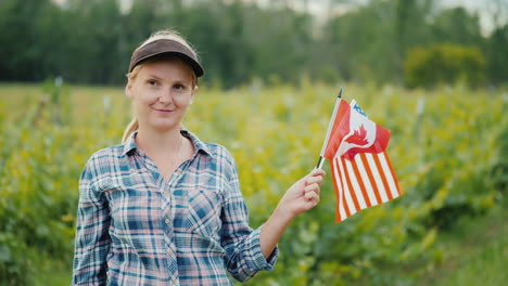 Portrait-Of-A-Farmer-With-Usa-And-Canada-Flags-In-Her-Hand